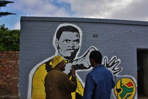Mr Madeli and Xolile Madinda in front of the Biko Bruce Lee mural